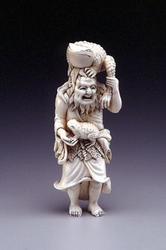 Attributed to Masaka,  Gama Sennin with two toads,  19th century, ivory,  height  3 7/8 in. (9.8 cm)