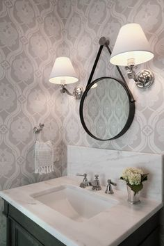 White marble countertop with circular mirror | Rethink Design