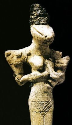 Snake head Goddes or Female figure, Feeding her Baby - terracotta, circa 5000-4000 BC, from Ubaid period before the Sumerians - at the Iraq Museum, Baghdad