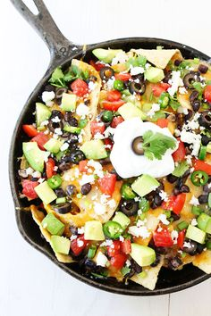 Three Cheese Skillet Nachos\ The Best Cast Iron Skillet Recipes For Your Next Meal