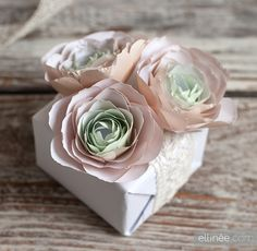 Elinee offers an excellent tutorial to make these paper ranunculus blossoms, lovely for a gift topper or a valentine.