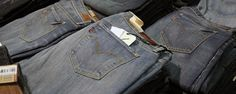 "Jeans are trousers, a type of garment, typically made from denim or dungaree cloth. Often the term ""jeans"" refers to a particular style of pants, called ""blue jeans,"" which were invented by Jacob W. Davis in partnership with Levi Strauss & Co. in 1871."