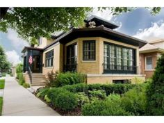 Dark windows with yellow brick. The Ultimate Bungalow - Portage Park Exterior Color Schemes, Exterior Paint Colors For House, Paint Colors For Home, Exterior Design, Bungalow Exterior, Bungalow Homes, Craftsman Bungalows, Yellow Brick Houses, Cottages And Bungalows