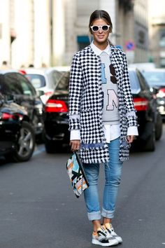 Must-See Street Style From Milan Fashion Week Fall 2015 - tweed black and white check coat, graphic sweatshirt over a white button-down shirt + cuffed skinny jeans and sneakers #must