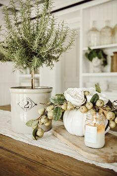 25 farmhouse decor centerpieces ideas that are seriously gorgeous 21 Rustic Farmhouse Decor, Farmhouse Style Decorating, Farmhouse Chic, Porch Decorating, Cottage Decorating, Pumpkin Vase, Pumpkin Centerpieces, Centerpiece Decorations, Kitchen Centerpiece