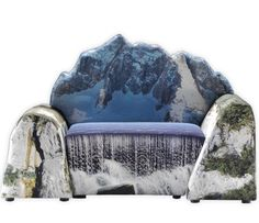 """Designer and architect Gaetano Pesce is the author of a chairs and armchairs collection named """"Montanara"""" and designed a few years ago. These chairs have been thought to bring a little of nature and freshness into the living rooms with their printing of mountains, lakes, waterfalls and trees."""