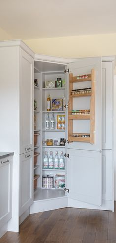 large pantry ideas We love this family kitchen with a mix of grey shaker kitchen doors. This kitchen has some great features, the corner kitchen pantry, large kitchen island with ope Corner Pantry Cabinet, Corner Kitchen Pantry, Kitchen Larder, Kitchen Pantry Design, Kitchen Pantry Cabinets, Home Decor Kitchen, Kitchen Storage, Family Kitchen, Kitchen Cabinets For Corners