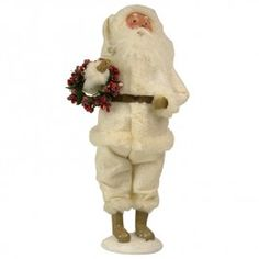 Byers' Choice Santa Collection, Winter White Santa   The Winter White Santa carries a wreath of red frosted berries to brighten the room. His white suit is trimmed in fur and dusted with glitter that reflects the light like freshly fallen snow