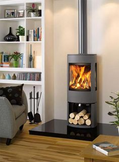 - Dovre Astroline Wood Burner with Wood Store Base Contemporary Wood Burning Stoves, Modern Stoves, Wood Stove Modern, Modern Log Burners, Log Burner Living Room, Wood Burner Fireplace, Fireplace Hearth, Fireplace Kitchen, Log Burning Stoves
