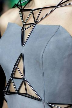 Structure of shapes with black surface additives to enhance the princess line in the grey leather bodice.