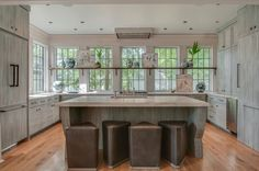 The kitchen has a hidden walk-in pantry, Thermador appliances, cypress custom cabinets and Turkish Carrarra marble countertops which together made for an at once WOW effect but never ostentatious.  Architect Jeffrey Dungan home in Nashville on StyleBlueprint.com