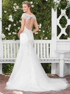 Gloriosa is a decorative and timeless option for the upscale modern socialite. The heavily beaded bodice and scoop neck shape builds into a wide keyhole back, ...