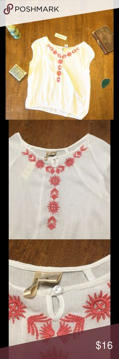 White Boho Chic Blouse Soft and comfortable white top with embroidered pink flowers. Cute little pom poms around the short sleeves. Stretchy at the bottom. Please make me an offer and comment below with any questions Tops Blouses