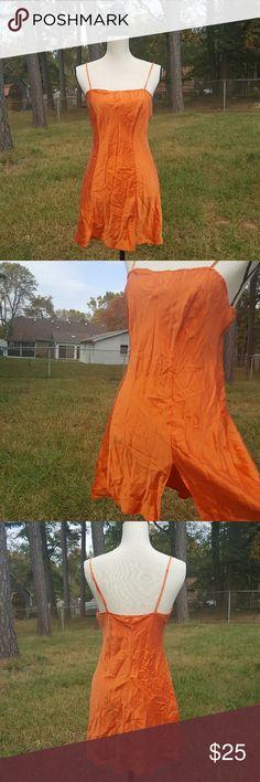 "Victoria's Secret Orange Silk Slip size M Victoria's Secret Size M  Orange silk slip in excellent condition.  Approx flat lay measurents  Underarm to underarm 16.5"" Length from underarm down 22.5"" Victoria's Secret Intimates & Sleepwear Chemises & Slips"