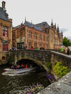 Canal  tourist boat - Bruges, Belgium. Want to discover Bruges by bike? Check out: http://www.bajabikes.eu/en/bike-tour-bruges