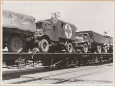 Army wagons on flat wagons, Canadian Military Pattern Vehicles, Tocumwal, NSW State Records NSW - Photo Investigator 11/02/1944