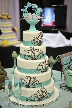 "This will be our wedding cake minus the birds on the top.  Going to have them incorporate ""XO"" and ""OX"" into the scrolls, too and not do a cake topper."