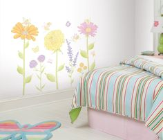 This lovely set of fairies and flowers is the perfect solution for moms who want colorful yet sophisticated nursery decor. Drawn by hand, this design features several playful fairies, butterflies, and
