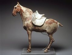 Figure of a Horse with Saddle, late 6th century. Northern Dynasties, Earthenware, traces of pigment, 19 1/2 x 22 x 5 1/2 in. (49.5 x 56.0 x 14.0 cm). Brooklyn Museum