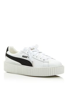 Fenty Puma x Rihanna Women's Creeper Platform Sneakers | Leather upper, fabric lining, rubber sole | Imported | Fits small, order the next size up | Round toe; lace up | Logo detail at tongue and s