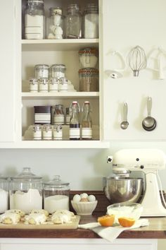 Beautifully organized baking cupboard. Love the hooks to hang the kitchen aid attachments!