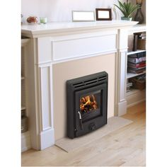 Takes up no room at all but the heat it gives out is fantastic. Inset Stoves, Open Fires, Modern, Room, Home Decor, Trendy Tree, Room Decor, Built In Cabinets, Rooms