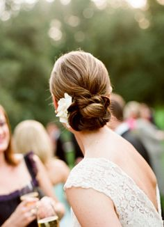 Photographer Lisa Lefkowitz got this gorgeous shot of a low, voluminous bun created by San Francisco-area hair and makeup stylist Betten Chaston. Wedding Hair Flowers, Wedding Hair And Makeup, Wedding Updo, Wedding Beauty, Flowers In Hair, Bridal Hair, Hair Makeup, White Flowers, Best Wedding Hairstyles