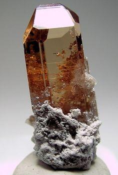 Sherry colored Topaz with Rhyolite matrix, from Pismire Wash, Maynard's Claim, Thomas Range, Juab County, Utah, USA