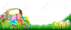 Basket full of decorated chocolate Easter eggs and flowers in a field ,