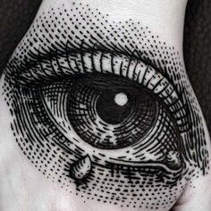 Mens Detailed Eye With Tear Drop Woodcut Hand Tattoo