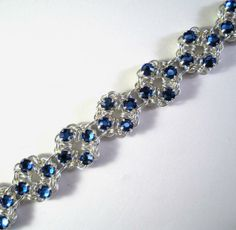 #diy #chainmaille Chain Maille Patterns   Chain Maille Flower Bracelet in Sapphire Blue Swarovski Crystal ...