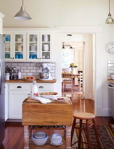 """White kitchen with subway tile in old Craftsman cottage via What It Was Like to Film the Pilot for """"Home Town"""" on HGTV - Hooked on Houses"""