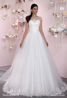 Corset A-line wedding dress. Satin bodice, decorated with lace, on the waist three thin belts. Skirt – tulle, decorated with lace on the bottom.