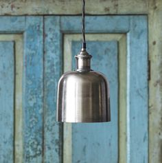 A very dainty and directed pendant light is Delia.  The antique silver finish and olive twisted silk flex work a treat