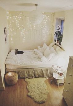 I love the coziness of the bed being snuggled up between the walls like that. Plus twinkly lights.