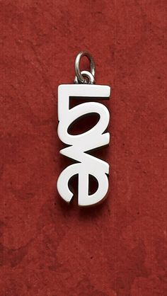 """Love"" Charm - Put your true feelings on display with a charm that expresses what's inside your heart, in a design that evokes warm memories and unending commitment. #JamesAvery #Love #Charms"