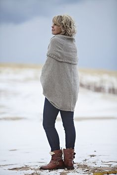 Once you put this one on, you may never take it off! That is how cozy you will be in your Ice Shanty. The very unique construction will envelope you in an oversized sweater that dips way down in the back but sits at your waist in the front. Kangaroo pockets and a HUGE shawl collar, along with a unique three-quarter sleeve, are just right for a bit of hip indoor/ outdoor glamour.