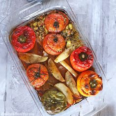 A bird's eye image of an oven dish of gemista. Vegetable Puree, Vegetable Recipes, Vegetable Pizza, Egyptian Food, Egyptian Recipes, Ethnic Recipes, Fresh Vegetables, Fresh Herbs, Gemista Recipe