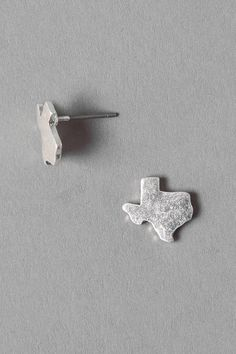 """Dreaming starry skies, tasty BBQ & true southern hospitality? Then it's time to represent the lone star state with the Road Trip Texas Studs in Silver!<br /> - 0.5"""" width<br /> - Lead & nickel free<br /> - Imported"""