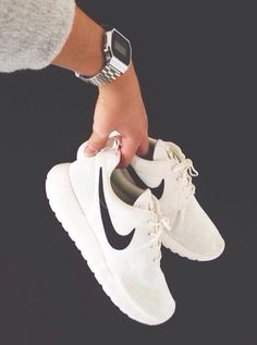 White Nikes and silver Casio watch