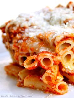 Baked Ziti - one of my favorite dishes to feed a crowd. Easy and comfort food at its best. the-girl-who-ate-everything.com