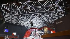 SPACE FRAME - light sculpture and kinetic lighting installation The Vodafone stand at the CeBIT 2014 features a monumental light installation composed of Interior Exterior, Interior Architecture, Paper Installation, Exhibition Booth Design, Exhibit Design, Exhibition Ideas, Space Frame, Displays, Frame Light