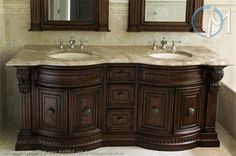 This dual sink vanity feature Daino Reale contrasting against the dark wood used for the cabinets and mirror frames.