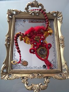 """Unique handmade necklace """"Adela"""" lined with red coral beads,red velvet string as central element combining a lace and fur ribbons hand-sewn coral, Swarovski crystals, Czech glass beads, Murano glass beads,gemstone,metal meddalion with an angel creating a harmony of materials for an majestic appearance"""