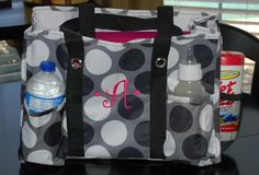Organizing Utility Tote by Thirty One.  Love the dots.  Would make a great diaper bag too!  ;)