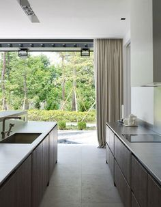 Asian Private House in Tranquil Color Scheme: Comfy Private Small Kitchen In Modern Design With Architectural View Window Featured With Priv...