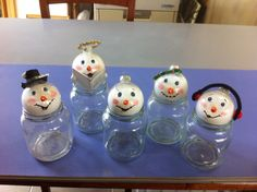 Just played with an idea from Pinterest. Use the hot glue gun, before it gets too hot, to build up some little carrot noses. Give bauble light spray with varnish. ( this helps your paint grip on the smooth surface) once dry paint on your face. Actually not in your face but your snowman's face. :-)
