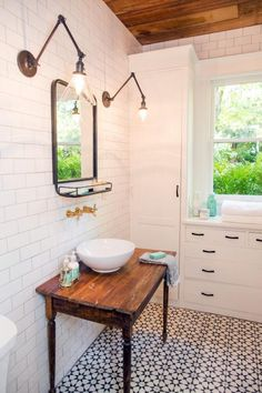 A close up of the vanity and new hardware in the bathroom of the newly renovated Childers home, as seen on Fixer Upper.