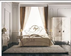 iron bed infront of window. Use curtains as added decor