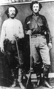"""Bill Tilghman 1854-1924 ( Bill is on the right )William Matthew """"Bill"""" Tilghman, Jr. (4 July 1854 – 1 November 1924), was a lawman and gunfighter in the American Old West.Buffalo hunter, frontier scout, saloon owner, Old West lawman, Oklahoma state senator, Oklahoma City police chief, film director and cinematographer"""